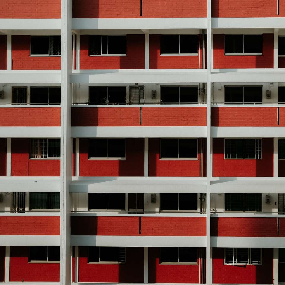 Features how most Singaporeans - White and red concrete building. Singapore (10×10)