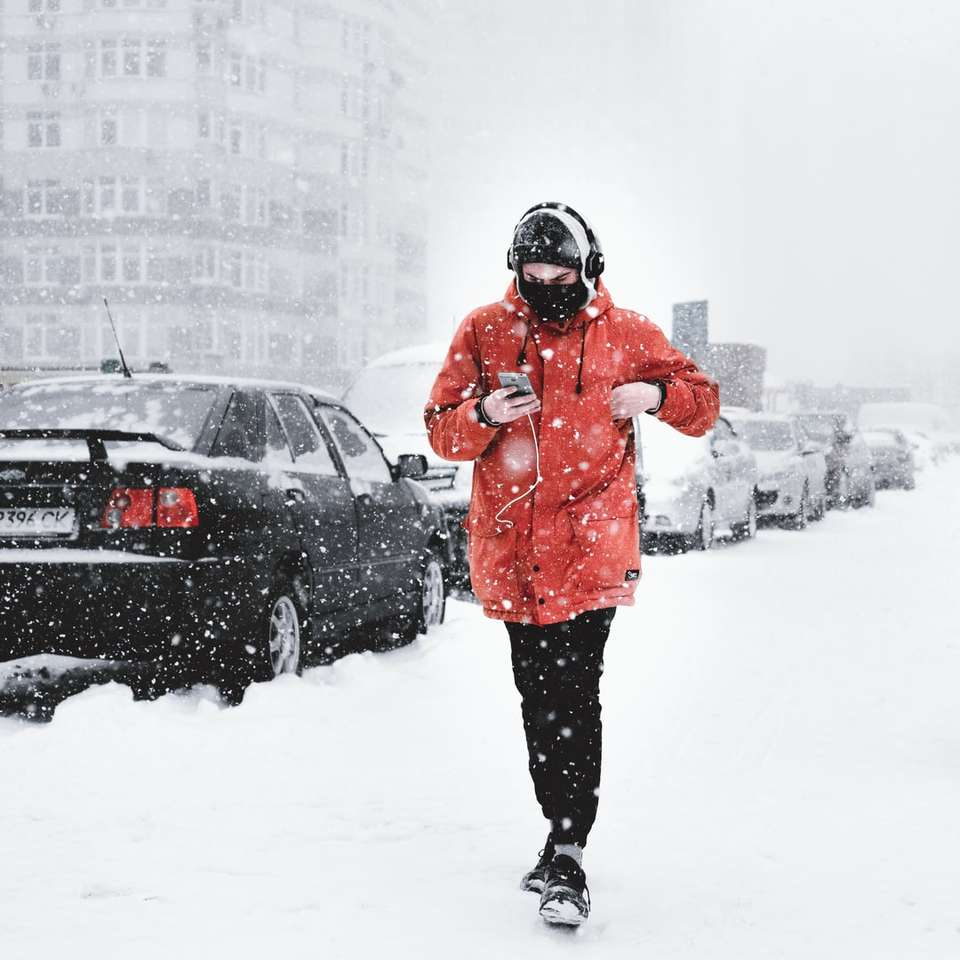 Man walking on the snow with phone -  (10×10)