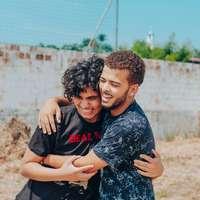 man in black crew neck t-shirt hugging woman