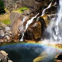 water falls on brown rock