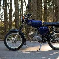 black standard motorcycle parked on brown dirt road