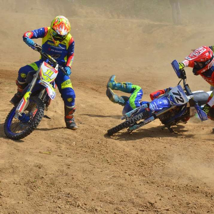 2 men riding motocross dirt bikes sliding puzzle