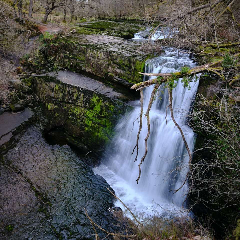 water falls on rocky mountain puzzle