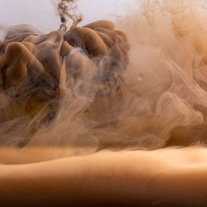white smoke on brown sand sliding puzzle