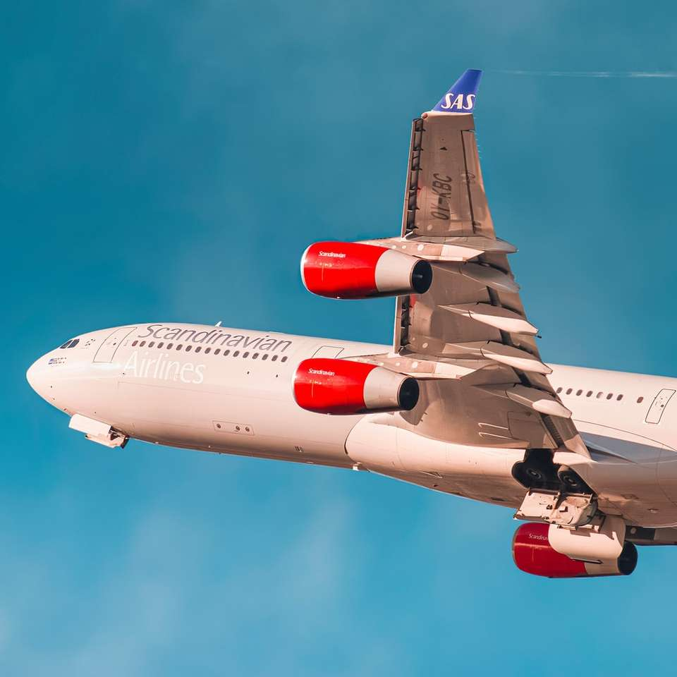 white and red passenger plane in flight sliding puzzle