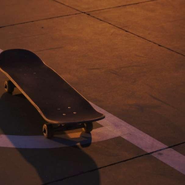 black skateboard on black concrete floor sliding puzzle