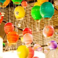 multicolored ceramic jars hanging on ceiling