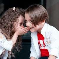 woman in white long sleeve shirt kissing girl