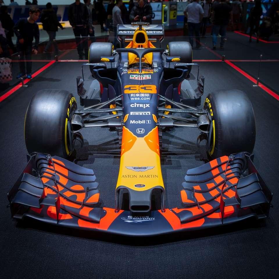 black and orange stock car