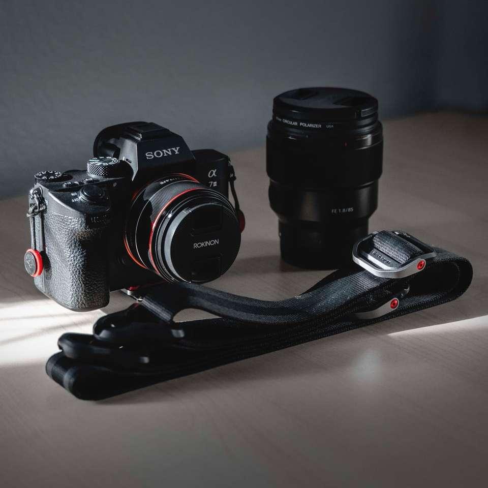 black Sony DSLR camera with lens