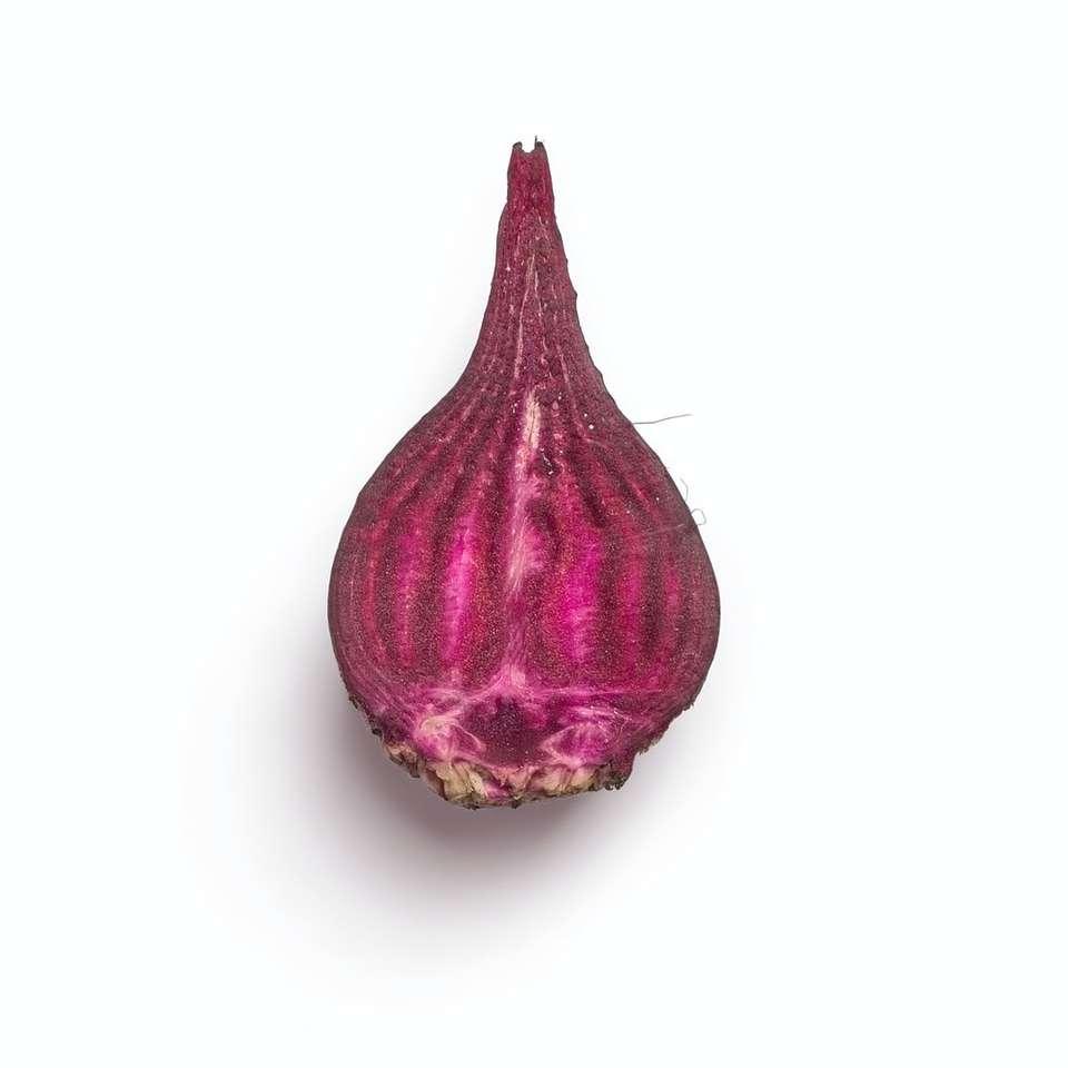 purple onion on white surface