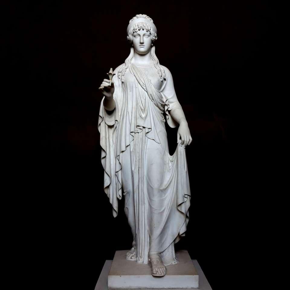 female grey concrete statue