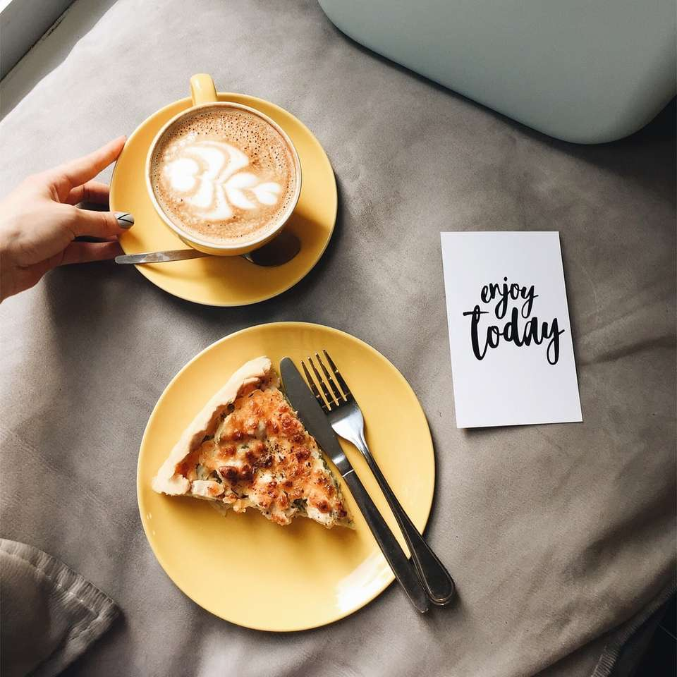 sliced of pizza and coffee latte