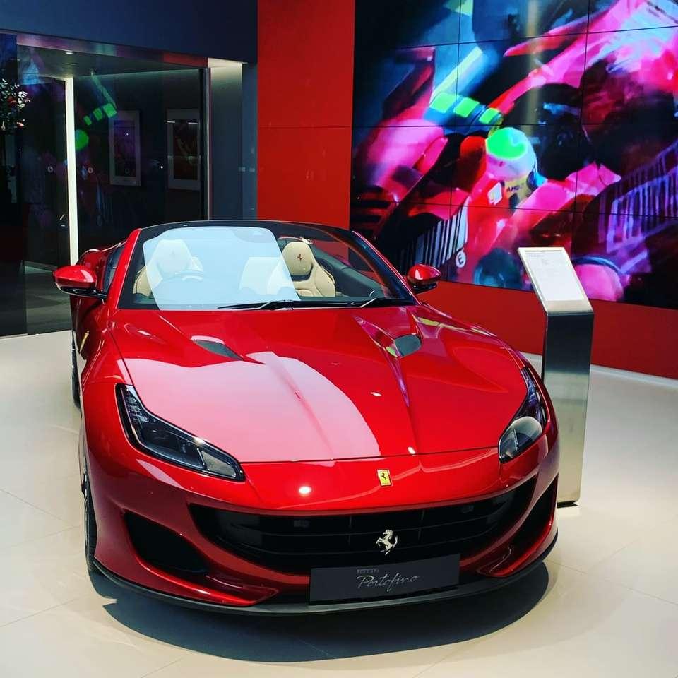 red ferrari sports car in a room
