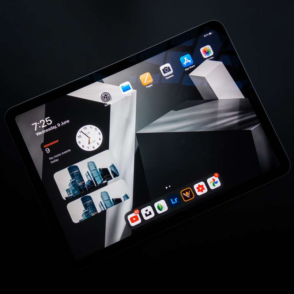 black ipad showing icons on screen
