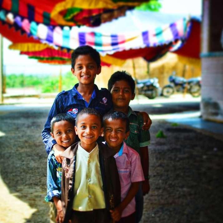 five boys standing outdoor focus photography