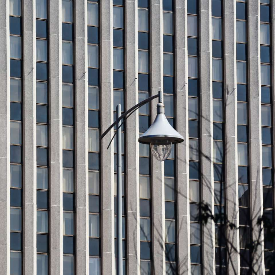 black street light near white concrete building
